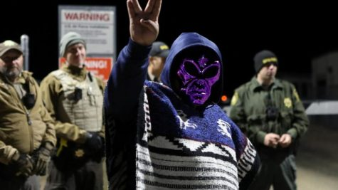 An Area 51 Raid attendee holds up the Vulcan peace sign in support of the theory that aliens are being hidden inside Area 51.