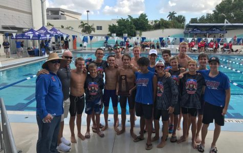 The Boys Swim Team, along with Coach Zuchowski and Dr. Hobbs after their regional championship win. (Photo Credit: Pace Edwards)