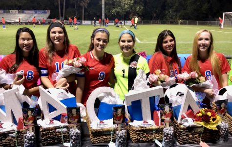 The senior girls receive their senior baskets after celebrating the victory of the game. (Photo Credit: Janice Rinker)