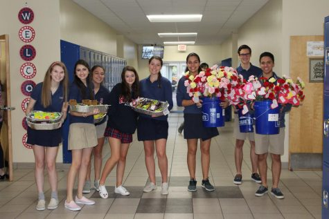 Key Club passes out the Candy and Carnations at the beginning of first period. (Photo Credit: Mrs Susan Lockmiller)