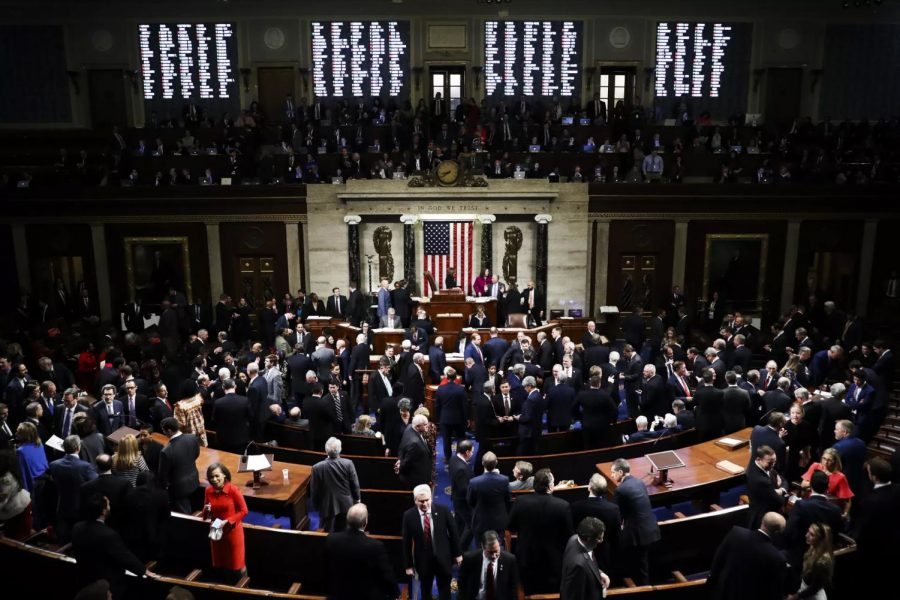 The House of Representatives votes to adopt the Articles of Impeachment against President Donald J. Trump (Photo Credit: Getty Images)