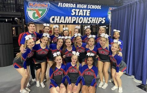 The King's Academy first male cheerleader, Mason Shipman, with the rest of the cheer team at the Competition Cheer State Championship. (Photo Credit: FHSAA)