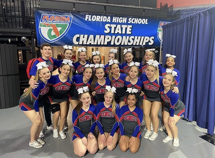 The+King%27s+Academy+first+male+cheerleader%2C+Mason+Shipman%2C+with+the+rest+of+the+cheer+team+at+the+Competition+Cheer+State+Championship.+%28Photo+Credit%3A+FHSAA%29