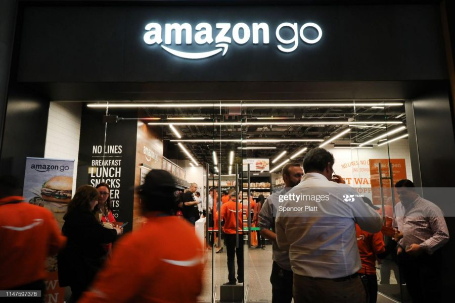 This image features people shopping in the new Amazon food store in New York City. It opened on May 7, 2019. The image demonstrates the amount of people interested in this new grocery store. (Photo Credit: Spencer Platt)